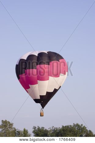 Hot Air Balloon Floating Above The Trees
