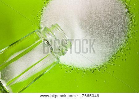 salt shaker on green