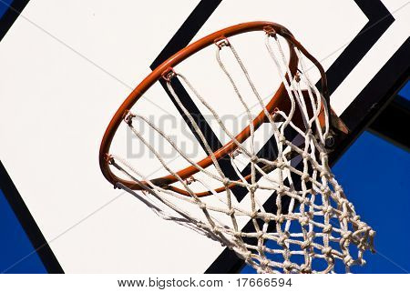 a basketball ring over a sunny blue sky