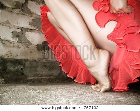 Female Legs Over Brick Wall Background