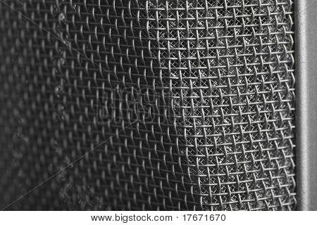 extreme closeup of memebrane of vintage microphone