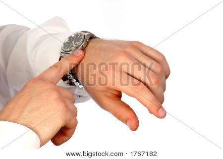 Businessman Looks Time