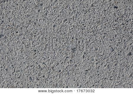 grey asphalt surface texture, extreme closeup photo