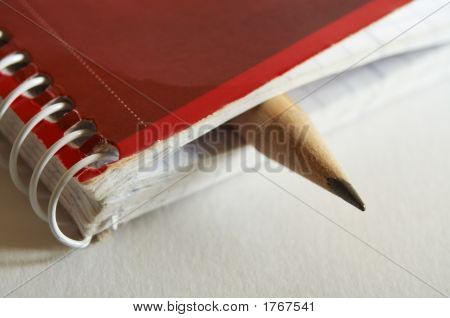 Pencil In Notebook