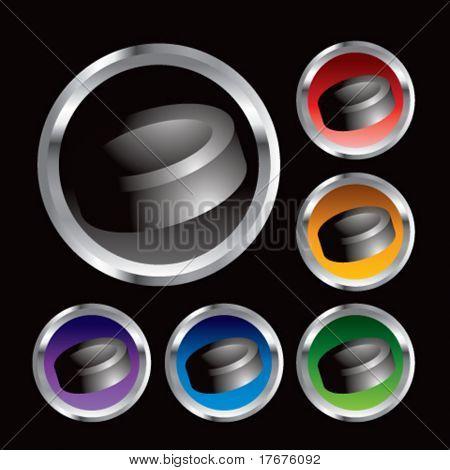 multiple colored round metal  hockey pucks