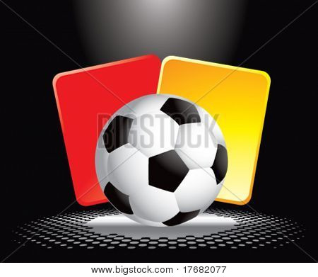 soccer ball and penalty cards under spotlight