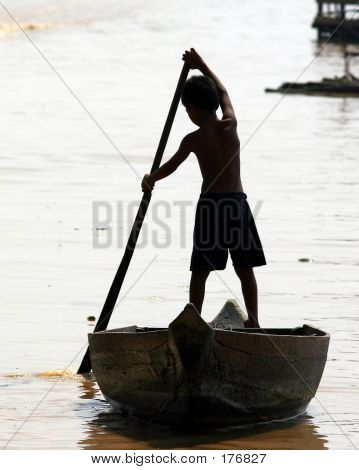 Young Boy Traveling By Boat.