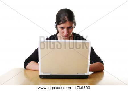 Young Woman In Headphones Working On Laptop.