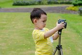 Thai Baby Photographer Shooting In Nature poster
