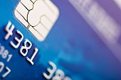 picture of debit card  - Close-up of silver digits and chip on a credit card 