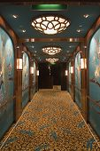 stock photo of cruise ship  - Ornate hallway decorated in an Asian style on board a cruise ship.