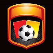 Постер, плакат: Футбольный мяч с красные и желтые карточки на оранжевый отображения