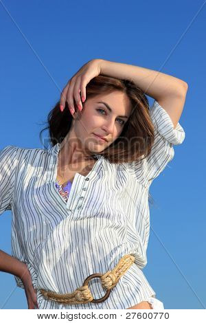 The beautiful model posing on the beach