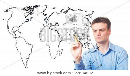 Businessman Drawing A City Of The Future