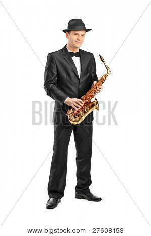 Full length portrait of a man in a suit holding a saxophone isolated on background