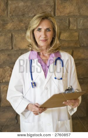 Doctor Standing With Charts
