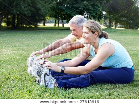 Senior Couple doing Yoga in the Park.