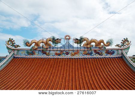 Two Old Dragons On A Roof