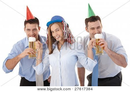 Young casual office workers having party fun after work, drinking beer, laughing.?