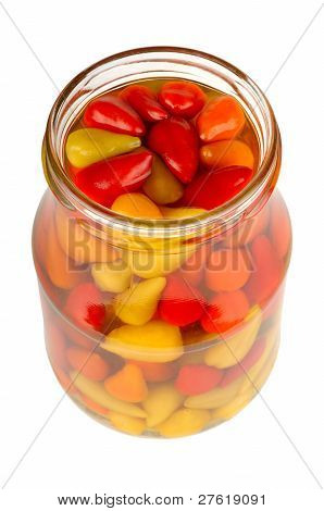 Canned Peppers In A Glass Jar Isolated On White Background