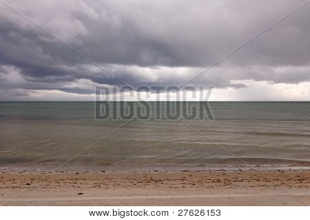 Heavy Storm Clouds Over A Calm Sea