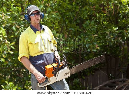Arborist with chain saw