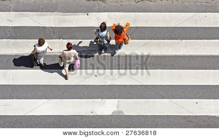 Pedestrians on a zebra crossing