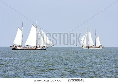 Flat bottomed boats sailing on the IJsselmeer in the Netherlands