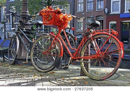 Orange bike designed with fall colours in the streets of Amsterdam the Netherlands