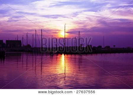 Beautiful purple sunset in the harbor of Marken in the Netherlands