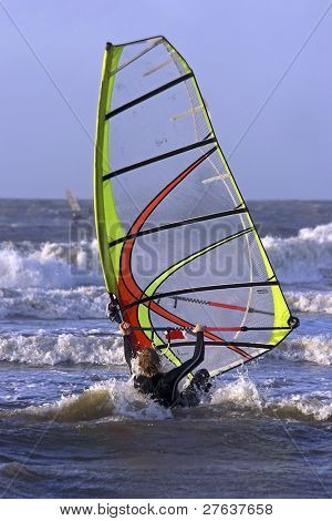 Windsurfer sufing on the north sea in Holland