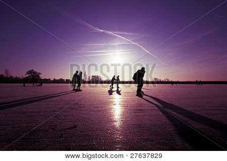 Ice skating at sunset in the Netherlands