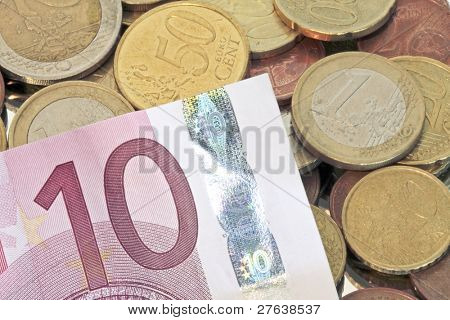 Euro coins with ten euro biljet