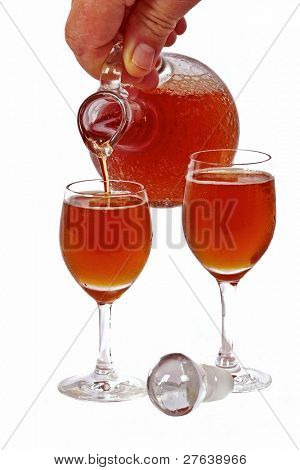 Pouring rose wine into glasses