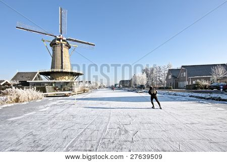 Ice skating on the canals in the countryside from the Netherlands