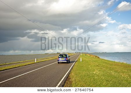 Driving on the dyke to Marken in the Netherlands
