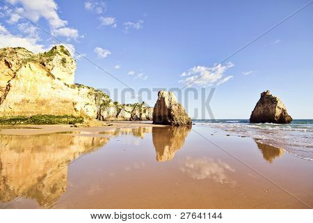 Natural rocks at praia tres irmaos in Alvor Portugal