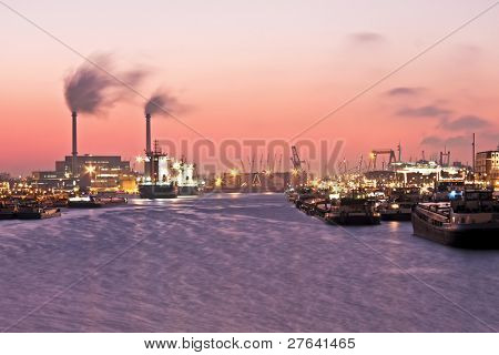 Beautiful sunset in the harbor from Rotterdam in the Netherlands