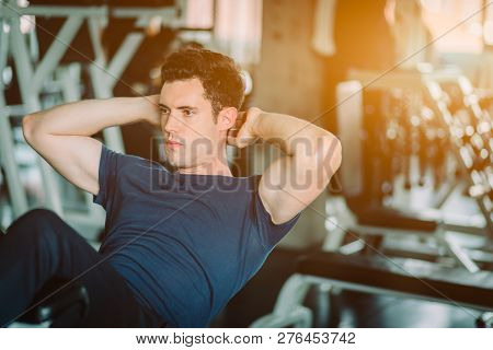 poster of Fit Caucasian Handsome Man Sit Up On Machine In Sportswear. Young Man Sit Up Exercise To Strength Th
