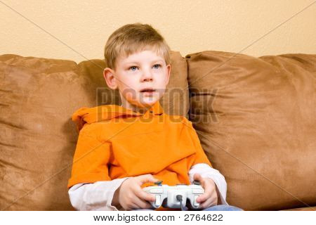 poster of Happy Young Boy Playing Video Game