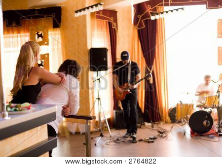 Couple Look At Playing Band