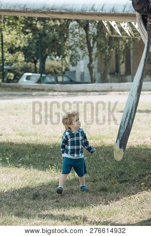 poster of Keep Calm And Travelling On. Small Child At Plane Field. Cute Boy Child On Vacation Trip. Small Kid