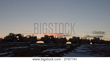 Heavy Construction Equipment At Sunset