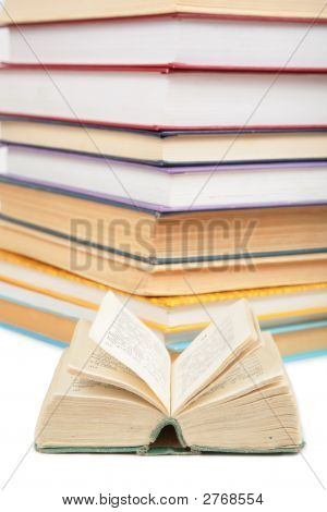 Big Stack Of Books And Opened Small Book
