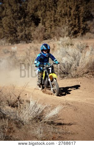 Young Motorcross Rider In Blue Gear