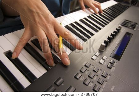 Woman'S Beautiful Hands On Digital Piano Keys