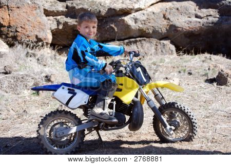 Young Boy In Blue On A Motorcross Dirtbike