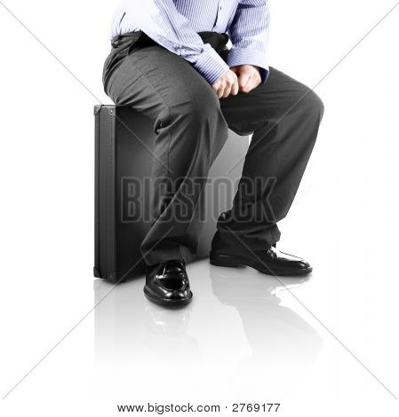 Sitting On A Briefcase (With Clipping Path And Reflection)