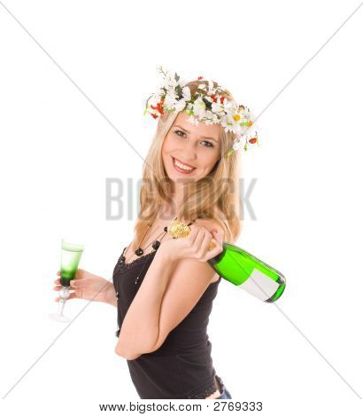 Smiling Blond In Colorful Wreath Holding Glass And Bottle