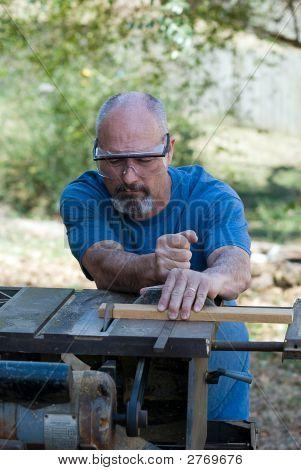 Man Using Table Saw